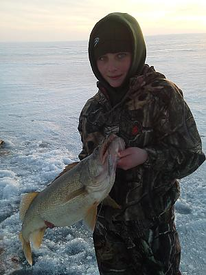 Will Tibbels age twelve with a 14 pounder caught in early March by Walleye_Rick in Main Album