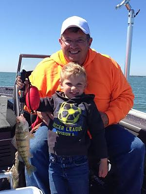 Matt and Son Wyatt fishing with Capt Juls